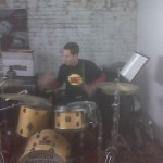 Jeff L Pounds The Drums While Wearing The BANG T-Shirt